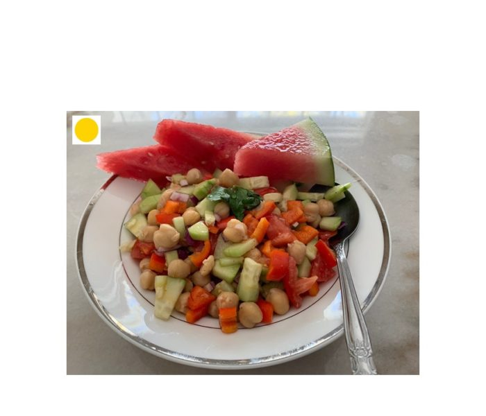 High protein salad with chickpeas, tomato, bell pepper, and cucumber